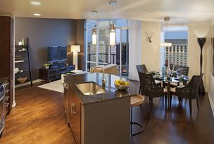 Contemporary Great Room with Chandelier, Laminate floors