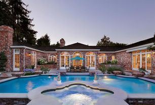 Traditional Swimming Pool with French doors, exterior awning, Pool with hot tub, Arched window, Raised beds