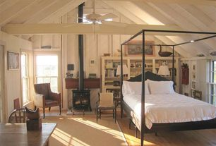 Cottage Master Bedroom with Ceiling fan, Exposed beam, metal fireplace, Modern four poster bed, Nantucket summer cottage