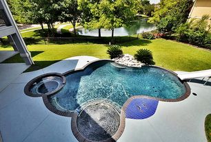 Modern Swimming Pool with Deck Railing, Fence, exterior stone floors, Pool with hot tub