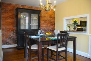 Modern Dining Room with Chandelier, Chair rail, Hardwood floors, Standard height