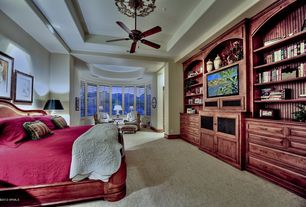 Traditional Guest Bedroom with specialty window, High ceiling, Carpet, Built-in bookshelf, can lights, Ceiling fan
