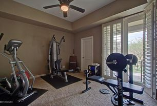 Modern Home Gym with French doors, Louvered door, Pure Fitness Exercise Ball with Pump, Ceiling fan, Carpet, Pendant light
