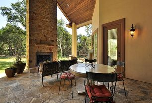 Craftsman Patio with outdoor pizza oven, French doors, Fence, exterior stone floors