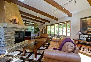 Craftsman Living Room with Hardwood floors, Exposed beam, flush light