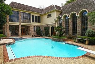 Traditional Swimming Pool with French doors, Pool with hot tub, double-hung window, exterior brick floors, Arched window