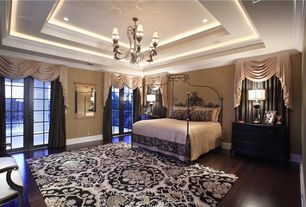 Traditional Guest Bedroom with can lights, High ceiling, Hardwood floors, Crown molding, French doors, Chandelier