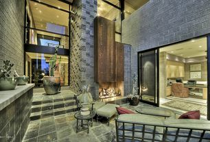Contemporary Living Room with Cathedral ceiling, stone fireplace, slate floors