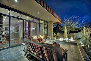 Modern Patio with exterior concrete tile floors, exterior tile floors, Fire pit, sliding glass door, Fence, Transom window