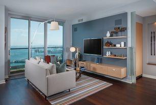 Contemporary Living Room with Carpet, Standard height, sliding glass door, Laminate floors, Built-in bookshelf