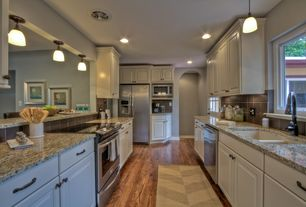 Traditional Kitchen with Undermount sink, Stone Tile, Galley, Raised panel, Hardwood floors, Simple granite counters