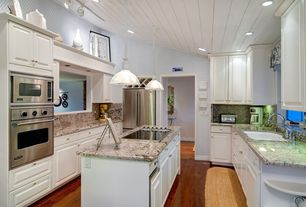 Traditional Kitchen with Hardwood floors, Oak - Cherry 2 1/4 in. Solid Hardwood Strip, Pendant light, High ceiling, U-shaped