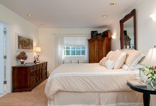 Traditional Guest Bedroom with Crown molding, Built-in bookshelf, Carpet