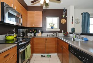 Contemporary Kitchen with gas range, Flush, Ceiling fan, drop-in sink, U-shaped, built-in microwave, partial backsplash