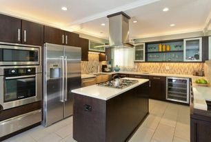 Contemporary Kitchen with Farmhouse sink, Ceramic Tile, U-shaped, Corian-Solid Surface Countertop in Designer White, Flush