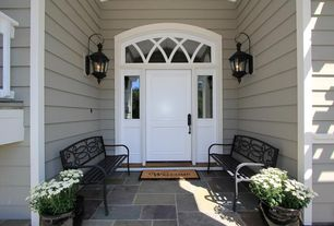 Traditional Front Door with Arched window, Sidelights, exterior stone floors, Transom window, Exterior paint