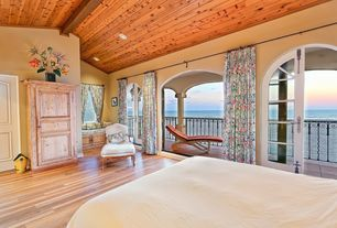 Craftsman Guest Bedroom with Window seat, High ceiling, French doors, Laminate floors