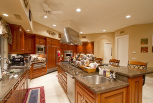 Traditional Kitchen with High ceiling, Breakfast bar, Ceiling fan, Vinyl floors, Ms international butterfly gold, Galley