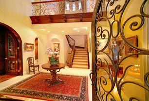 Mediterranean Entryway with limestone floors, Balcony, French doors, High ceiling