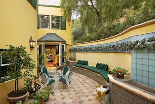 Eclectic Patio with Fence, exterior tile floors, French doors, exterior herringbone tile floors