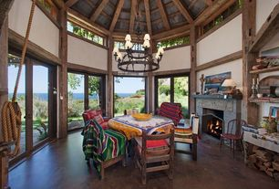 Country Dining Room with Reclaimed wood, Wood dining set, Clerestory window, Vaulted ceiling, stone fireplace, Glass door