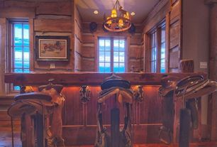 Eclectic Bar with Saddle bar stools, Saddle Bar Stool, Wood plank bar top, Buffalo Hunt Chandelier