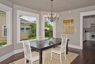Traditional Dining Room with double-hung window, Hardwood floors, Chandelier, Standard height