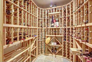 Traditional Wine Cellar with stone tile floors, Built-in bookshelf, Standard height, travertine tile floors
