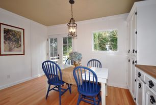 Cottage Dining Room with French doors, Crown molding, Laminate floors, Chandelier