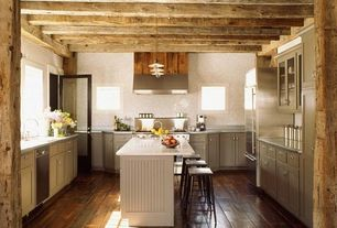Rustic Kitchen with Wall Hood, Standard height, Simple marble counters, electric cooktop, Pendant light, Kitchen island