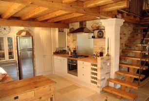 Rustic Kitchen with dishwasher, Flat panel cabinets, limestone tile floors, Wall Hood, Standard height, Flush, wall oven