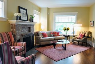 Traditional Living Room with Fireplace, brick fireplace, double-hung window, Casement, Hardwood floors, Standard height