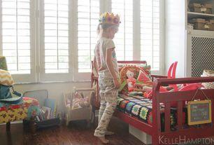Traditional Kids Bedroom with Casement, Built-in bookshelf, Hardwood floors, Standard height