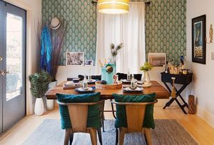 Contemporary Dining Room with Pendant light, Osborne & little peacock wallpaper, French doors, Laminate floors, Crown molding