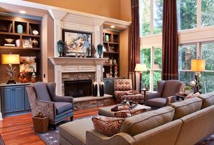Traditional Living Room with Hardwood floors, Built-in bookshelf, stone fireplace, High ceiling, Crown molding