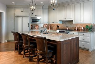 Traditional Kitchen with Pendant light, Breakfast bar, Custom hood, Kitchen island, Raised panel, One-wall, Undermount sink