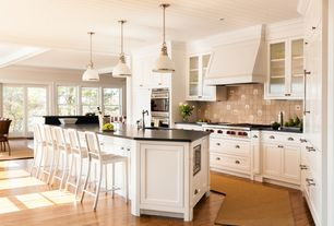 Traditional Kitchen with Shaker style cabinets, Quartz counters, Crate and Barrel Delta Aluminum Bar Stool, Pendant light