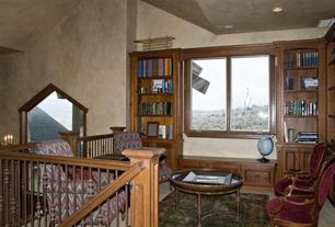Contemporary Home Office with Wainscotting, picture window, Casement, Built-in bookshelf, Standard height, Window seat
