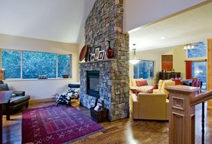Traditional Living Room with El Dorado Stone Rough Cut Stone - Moonlit, flush light, Laminate floors, stone fireplace