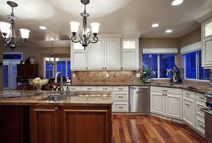 Traditional Kitchen with dishwasher, U-shaped, Kitchen island, gas range, full backsplash, specialty window, Casement