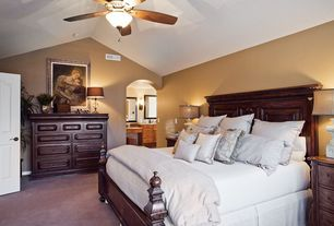 Traditional Master Bedroom with High ceiling, Carpet, Ceiling fan, six panel door