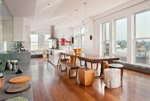 Contemporary Dining Room with West elm staggered wood dining table, Hardwood floors, Pendant light, Open concept, Paint