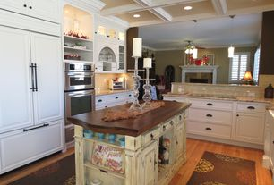 Traditional Kitchen with double wall oven, Built In Panel Ready Refrigerator, Subway Tile, can lights, Pendant light