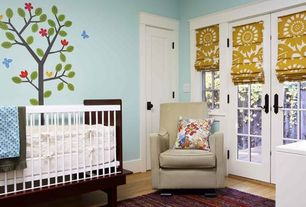 Contemporary Kids Bedroom with specialty door, The Land of Nod Luca Glider, Cobblestone 3-Piece Crib Set, High ceiling, Mural
