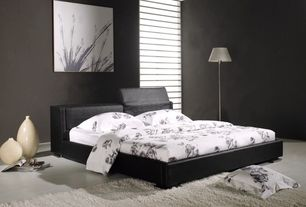 Modern Master Bedroom with In style furnishing black upholstered platform bed, Safavieh shag white rug