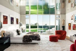 Contemporary Master Bedroom with Linie design maltino white area rug, Savannah microfiber club chair, Paint, Casement