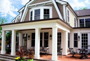 Traditional Porch with French doors, double-hung window, exterior terracotta tile floors, Fence, exterior tile floors
