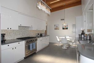 """Contemporary Kitchen with Flush, Eero Saarinen 47"""" Dining Table, Stainless steel counters, Glass Tile, Exposed beam, U-shaped"""