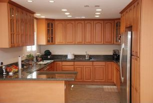 Traditional Kitchen with Glass panel, Built In Refrigerator, Stainless steel sink, Framed Partial Panel, partial backsplash