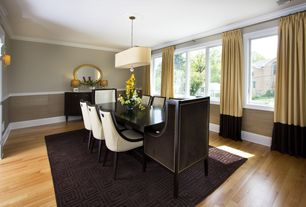 Contemporary Dining Room with Wall sconce, Pendant light, Chair rail, Hardwood floors, Crown molding